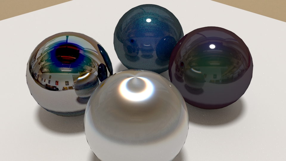 Vier Kugeln mit unterschiedlichen Materialien