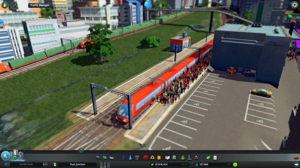 Zugreisende am Bahnhof